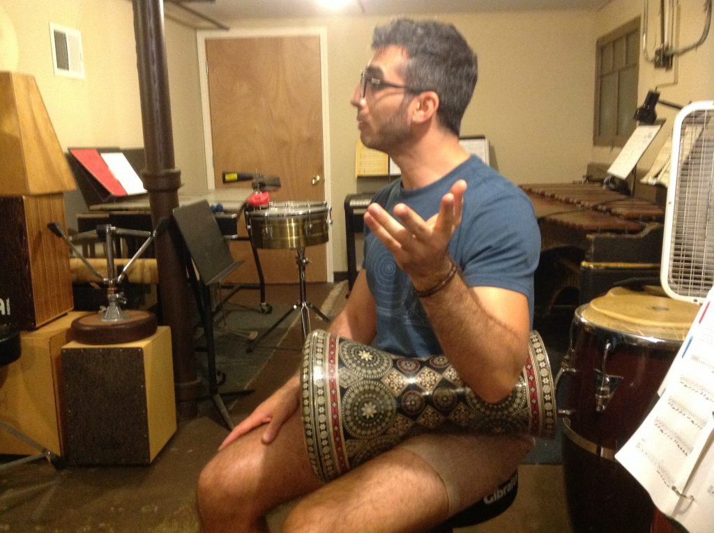 Tarek with a drum